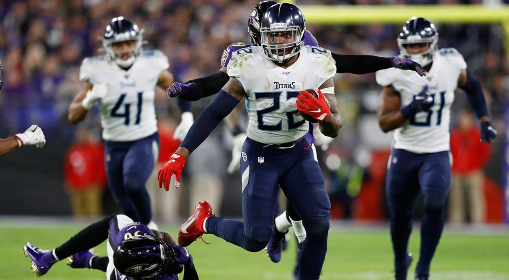 Tennessee Titans running back Derrick Henry (22) runs past Baltimore Ravens strong safety Chuck Clark (36) during the second half of a divisional playoff game.