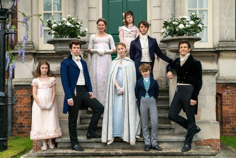 Cast of Bridgerton from Left to Right (Florence Hunt, Luke Newton, Ruth Gemmell, Pheobe Dynevor, Claudia Jessie, Jonathan Bailey, Will Tilston, Luke Thompson)